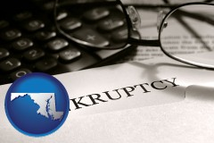 maryland a bankruptcy notice letter with calculator and eyeglasses