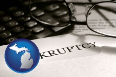 michigan a bankruptcy notice letter with calculator and eyeglasses
