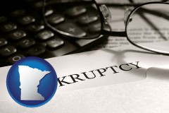 minnesota a bankruptcy notice letter with calculator and eyeglasses