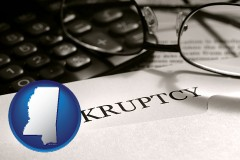 mississippi a bankruptcy notice letter with calculator and eyeglasses