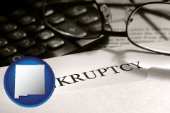 new-mexico a bankruptcy notice letter with calculator and eyeglasses