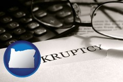 oregon a bankruptcy notice letter with calculator and eyeglasses