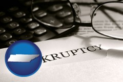 tennessee a bankruptcy notice letter with calculator and eyeglasses