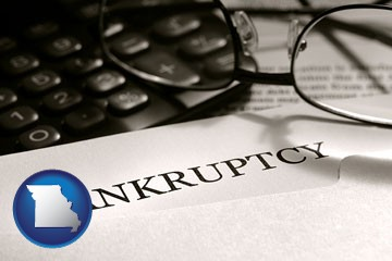 a bankruptcy notice letter with calculator and eyeglasses - with Missouri icon