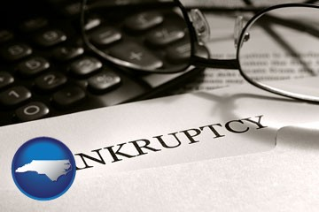 a bankruptcy notice letter with calculator and eyeglasses - with North Carolina icon